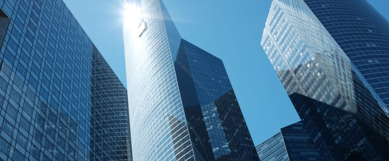 Real Estate insurance - image of high-rise building taken from the bottom with view to the top
