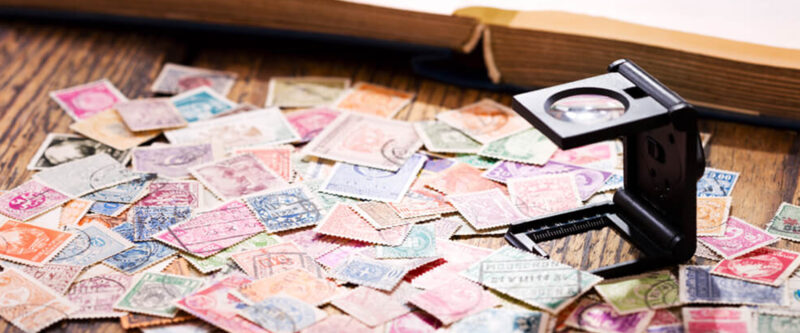 Stamp Collection with mini magnifying glass