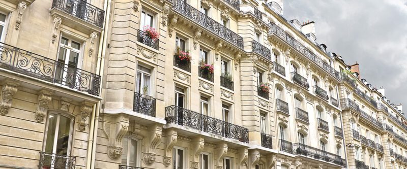Facade of a traditional building in downtown Paris, France