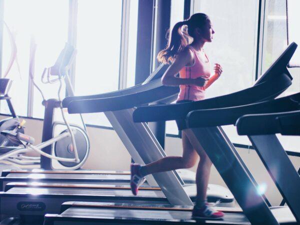 Woman on treadmill fitness studio