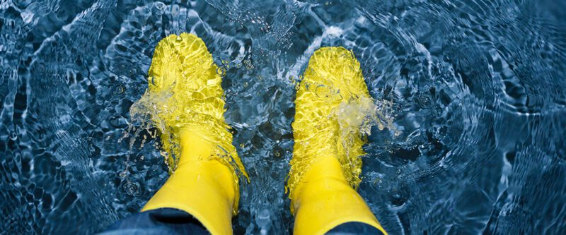 Flood insurance - image of yellow boots in water
