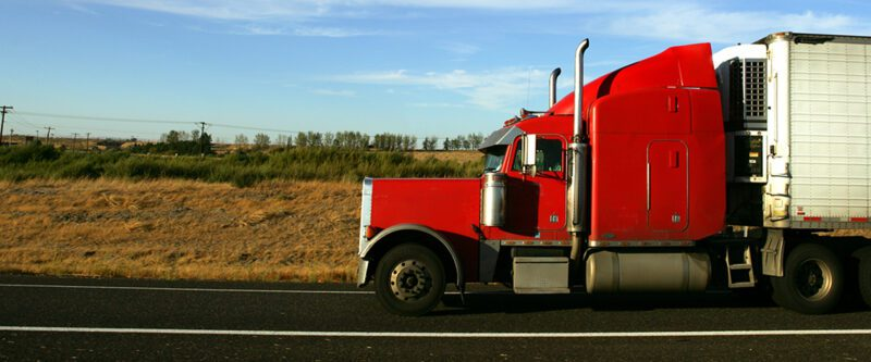 Transportation Insurance - Red Truck on road
